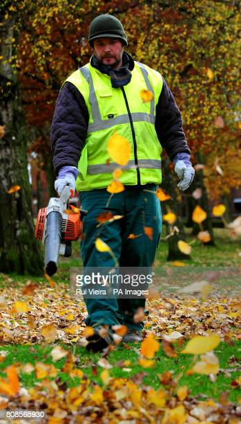 A worker clears leaves with a leaf blower in Swadlincote south Derbyshire during autumnPicture date Friday November 5 2010