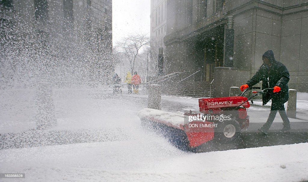 A worker clears snow outside the Federal Courthouse in Manhattan March 8, 2013 in New York. Inside the court the son-in law of Osama bin Laden, Sulaiman Abu Ghaith, pleaded not guilty Friday to charges of terrorism which he was formally charged by a New York court. The New York judge has ordered that Abu Gaith, who wore a short gray beard, 'remains in custody' until the next hearing scheduled for April 8.