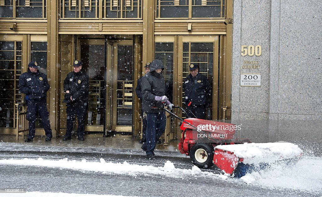A worker clears snow outside the Federal Courthouse in Manhattan March 8, 2013 in New York. Inside the court Osama bin Laden's son-in-law and former spokesman pleaded not guilty Friday to terrorism charges in New York, where he was brought a week ago after a top secret US operation. Sulaiman Abu Ghaith, reportedly a 47-year-old Kuwaiti and allegedly a senior propagandist in the Al-Qaeda network, is accused of conspiring 'to kill nationals of the United States.'