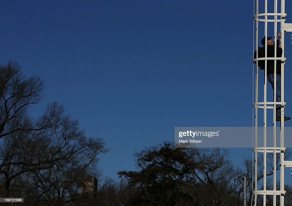 A worker climbs a camera tower in front of the U.S. Capitol Building on January 19, 2013 in Washington, DC. The U.S. Capitol is preparing for the second inauguration of U.S. President Barack Obama, which will take place on January 21.