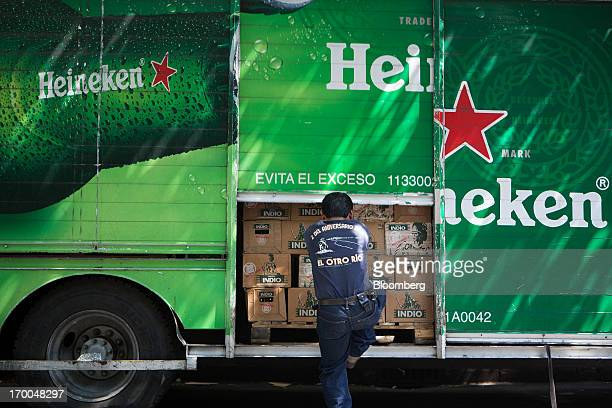 A worker closes the door of a delivery truck operated by CuauhtemocMoctezuma a subsidiary of Heineken NV in Mexico City Mexico on Thursday June 6...
