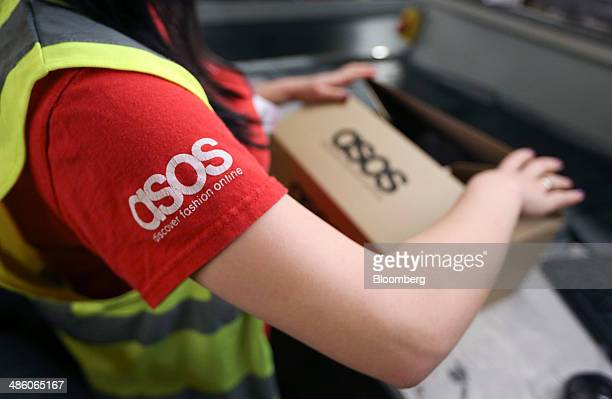 A worker completes a customer's order ahead of shipping at Asos Plc's distribution warehouse in Barnsley UK on Tuesday April 22 2014 Asos the UK's...