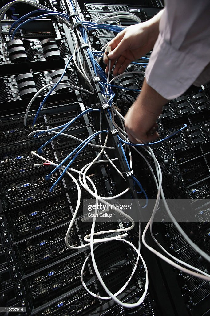 A worker connects IBM Intelligent Cluster modules, including servers and data storage devices, of a Data Center at the IBM stand the day before the CeBIT 2012 technology trade fair officially opens to the public on March 5, 2012 in Hanover, Germany. CeBIT 2012, the world's largest information technology trade fair, will run from March 6-10, and advances in cloud computing are a major feature this year.