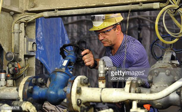 A worker controls a cement mixer producing the concrete which is used to fill cracks occured at the Asse II nuclear waste storage facility which is...
