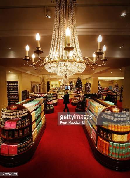 A worker crosses the newly refurbished food hall at Fortnum amd Mason on October 30 2007 in London London's most famous food shop will celebrate it's...