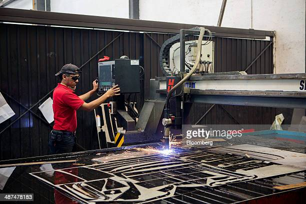 A worker cuts a steel plate at Ballistic Protection Co's armored car workshop in Mexico City Mexico on Tuesday April 29 2014 Mexico's yearoveryear...
