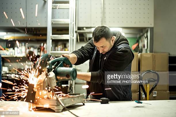 Worker cutting metal material