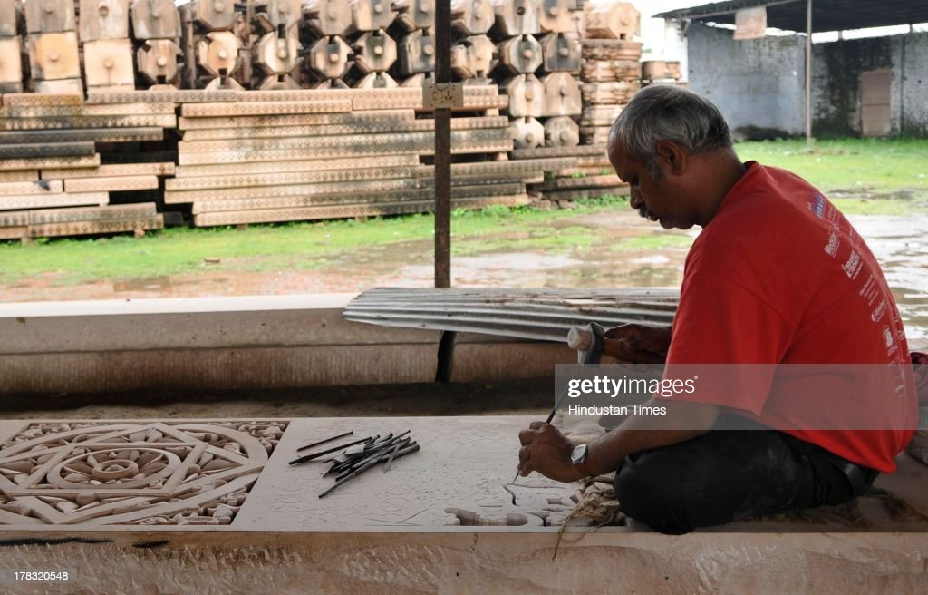 A worker cutting stone in workshop run by VHP for preparation to build Ram temple even though the case of the disputed land is in the Supreme Court on August 28, 2013 in Ayodhya, India. Three days after Vishwa Hindu Parishad (VHP) field Parikarma attempt, Ayodhya saw a heavy presence of security personnel amid Janmashtmi celebrations.