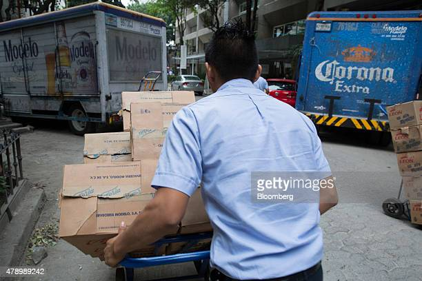 A worker delivers Constellation Brands Inc Modelo and Corona beer to customers in the Zona Rosa neighborhood in Mexico City Mexico on Wednesday June...