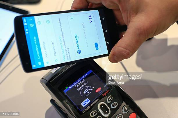 A worker demonstrates a mobile payment system at the Visa Inc stand at the Mobile World Congress in Barcelona Spain on Monday Feb 22 2016 Mobile...