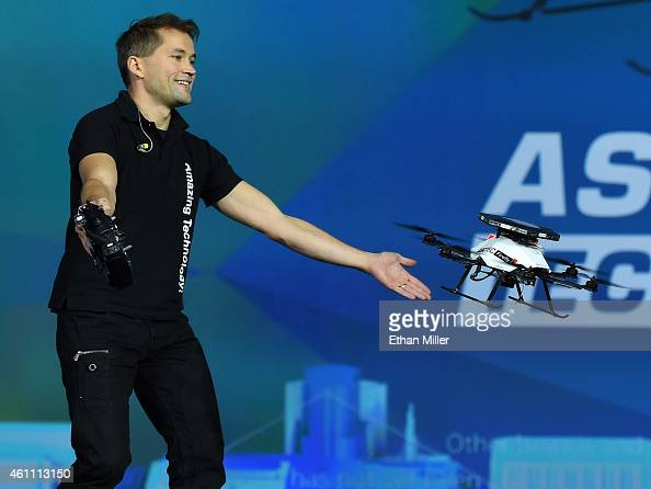 A worker demonstrates the collision avoidance capability of an AscTec Firefly multicopter drone with Intel RealSense cameras during a keynote address...