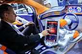 A worker demonstrates the Harman International Industries Inc Rinspeed Budii concept car at the Mobile World Congress in Barcelona Spain on Monday...