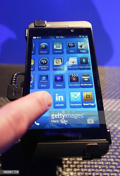 A worker demonstrates the use of the new BlackBerry Z10 at the BlackBerry 10 launch event at Pier 36 in Manhattan on January 30 2013 in New York City...