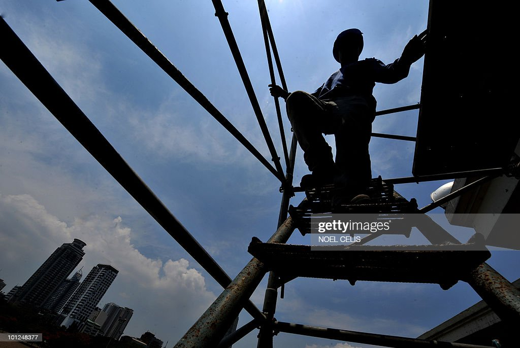 A worker descend from a scaffolding at a construction site in Manila on May 29, 2010. Philippine President Gloria Arroyo will hand over a booming economy when she steps down next month, her office said May 27 after data showed better-than-expected 7.3 percent growth in the first quarter. The year-on-year expansion was the strongest in almost three years and gave some relief to Arroyo who has been portrayed by critics as a corrupt ruler more focused on improving her family's economic fortunes than the nation's. Nevertheless, critics accuse her of mismanaging the economy, saying the rich-poor divide has worsened and the Philippines has generally fallen further behind its Asian neighbours.
