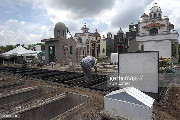 A worker digs new tombs at the 'Humaya Gardens' cementery on July 13 2011 in Culiacan Sinaloa state Mexico In a private cemetery in Sinaloa the...