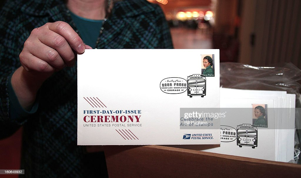 A worker displays a First Day of Issue stamp of the new Rosa Parks stamp, a commemorative stamp issued by the U.S. Postal Service honoring civil rights icon, February 4, 2013 at The Henry Ford in Dearborn, Michigan. The stamp went on sale February 4, 2013, what would have been Rosa Park's 100th birthday.