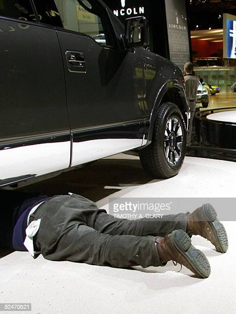 A worker does some lastminute work on one of the new Lincoln trucks during the 2005 New York Auto Show at the Jacob Javits Convention Center in New...