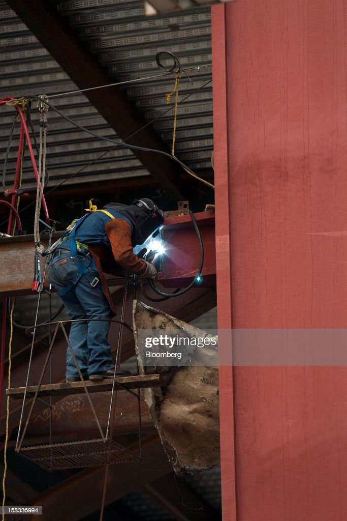 A worker does welding on a steel beam at the construction site of the BBVA Bancomer Tower in Mexico City, Mexico, on Thursday, Dec. 13, 2012. The office for BBVA Bancomer, the Mexican unit of Banco Bilbao Vizcaya Argentaria SA, Spain's second-biggest bank, will have 50 floors and accommodate about 4,500 employees when it is completed. Photographer: Susana Gonzalez/Bloomberg via Getty Images
