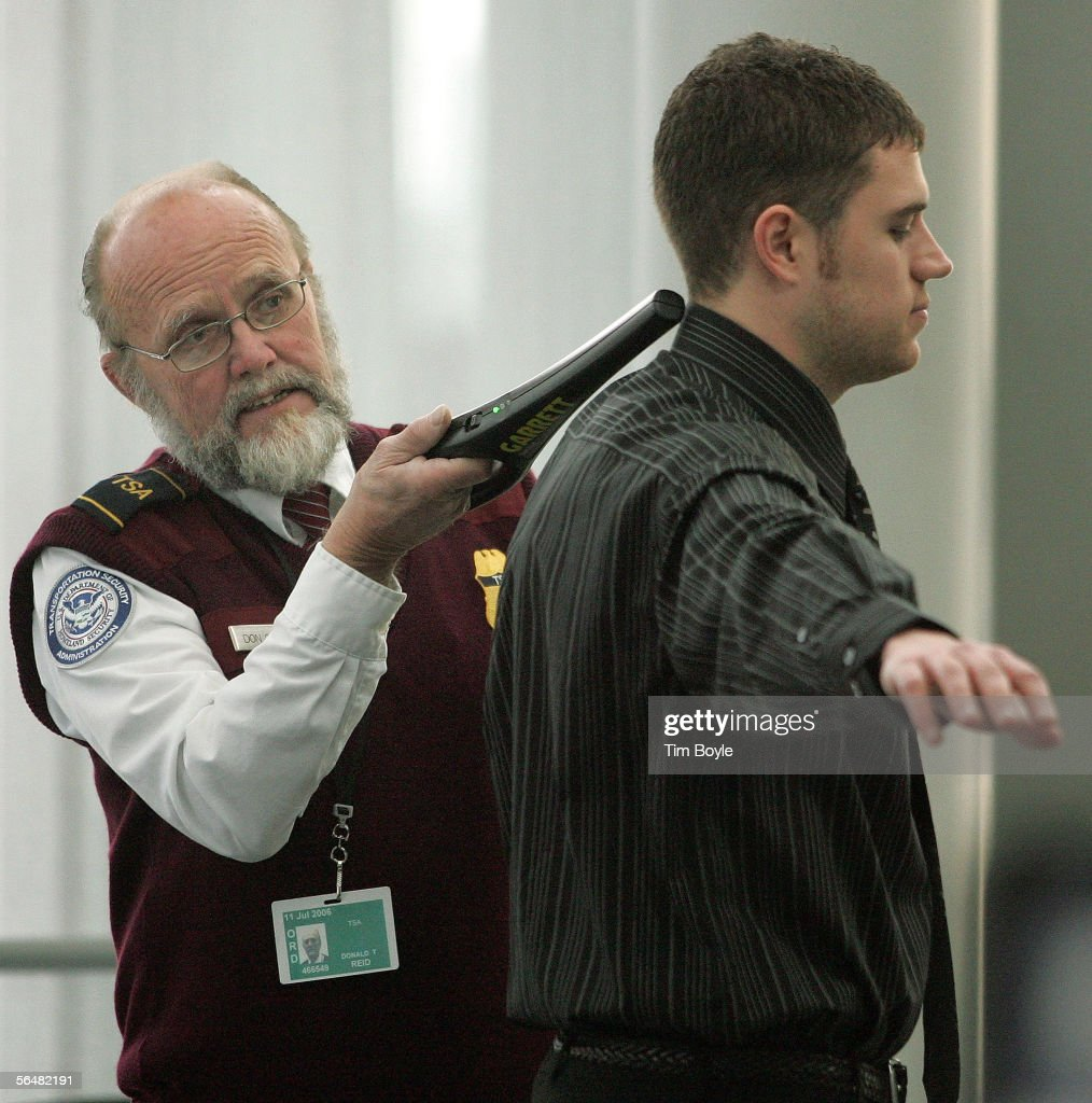 TSA worker Donald Reid checks a traveler at a security post at O'Hare International Airport December 22, 2005 in Chicago, Illinois. According to the TSA, security measures will be stepped up during the busy holiday travel season when, in an estimation by AAA, 63.5 million Americans plan to travel 50 miles or more.