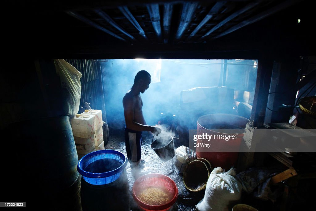 A worker drains and rinses soy beans after they have been boiled at a small tempeh factory on July 12, 2013 in Jakarta, Indonesia. Tempeh is an Indonesian staple made from fermented soy beans. The Indonesian government has said that it will increase food imports during the Ramadan fasting month to reduce inflation caused by increased food consumption during the month leading up to and during the Eid Al Fitr holiday marking the end of the fasting month.