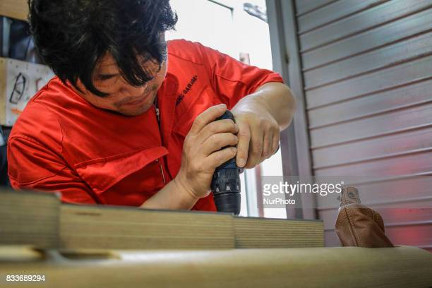Worker drilling wood interior part at mohenoc garages in Paju South Korea A 20yearold beat up Hyundai SUV isn't anyone's idea of a dream car But used...