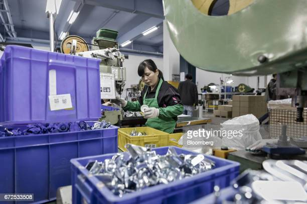 A worker drills a caster wheel at a factory operated by the Guangdong Shiyi Furniture Co in Foshan China on Tuesday Feb 28 2017 Startup EDeodar a...