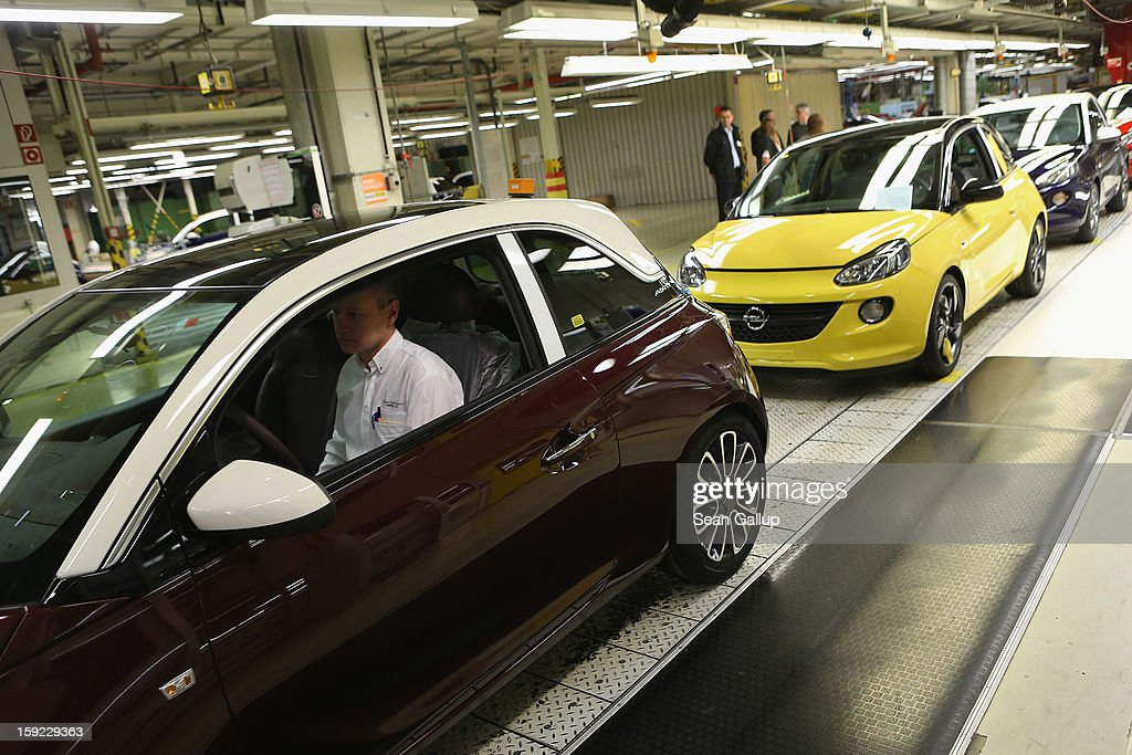 A worker drives a finished Opel Adam car from the assembly line shortly after a celebration to mark the launch of the new Opel compact car at the Opel factory on January 10, 2013 in Eisenach, Germany. Opel employees hope the car will help the compny return to profits after years of sagging sales and the announcement of the Bochum factory closure in 2016.