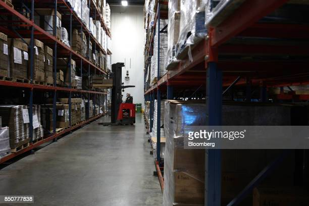 A worker drives a forklift in a stockroom at the Tulkoff Food Products Inc factory in Baltimore Maryland US on Tuesday Aug 29 2017 While economists...