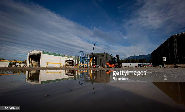 A worker drives a forklift past a building under construction at the Seaspan Vancouver Shipyard in North Vancouver British Columbia Canada on...
