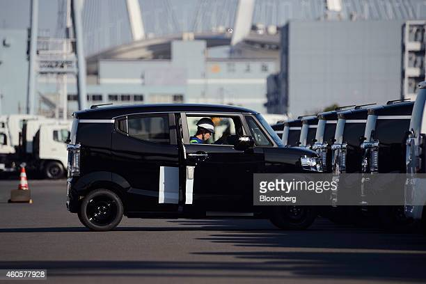 A worker drives a Honda Motor Co vehicles bound for shipment at a yard in Yokohama Japan on Monday Dec 15 2014 Japans exports rose less than forecast...