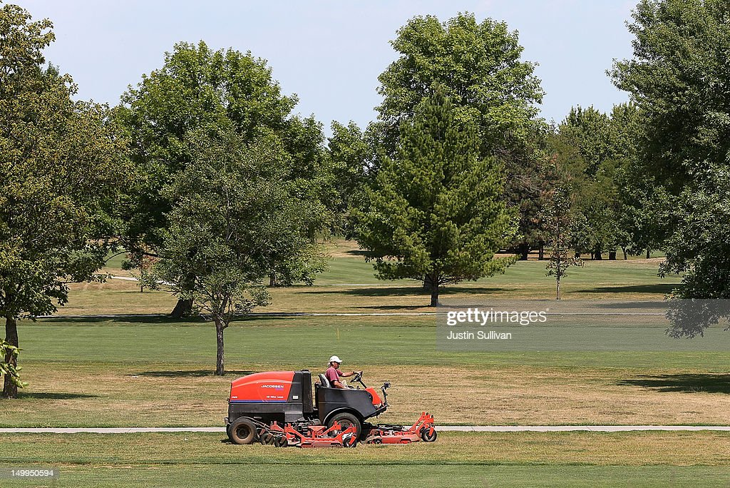 A worker drives a mower over brown grass at Jester Park Golf Course on August 7, 2012 in Granger, Iowa. An exceptionally hot summer and the worst drought in more than a half century has caused cut prospects for the U.S. corn crop to a five-year low and has sent prices up to over $8.00 a bushel in late July trading. The price surge and limited supply has also prompted ethanol plants to voluntarily slow production by 20 percent, a two year low.