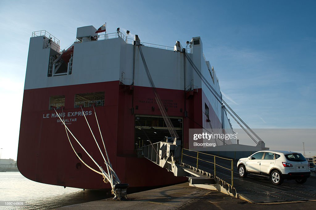 A worker drives a new Nissan Motor Co. Qashqai SUV automobile aboard the Le Mans Express roll on, roll off (RoRo) ship at Barcelona port in Barcelona, Spain, on Thursday, Jan. 10, 2013. Spanish exports grew the least in five months in September as the euro area relapsed into a recession and the region's fourth-largest economy continued to contract. Photographer: David Ramos/Bloomberg via Getty Images
