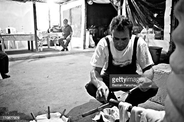 A worker during a raki production controls the alcohol content of his raki at the distillery on October 23 2009 in Heraklion Greece Raki is a...