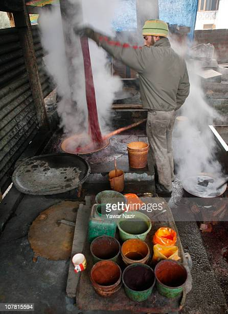 A worker dyes pashmina shawls at his workshop December 29 2010 on the outskirts of Srinagar the summer capital of Indian administered Kashmir India...