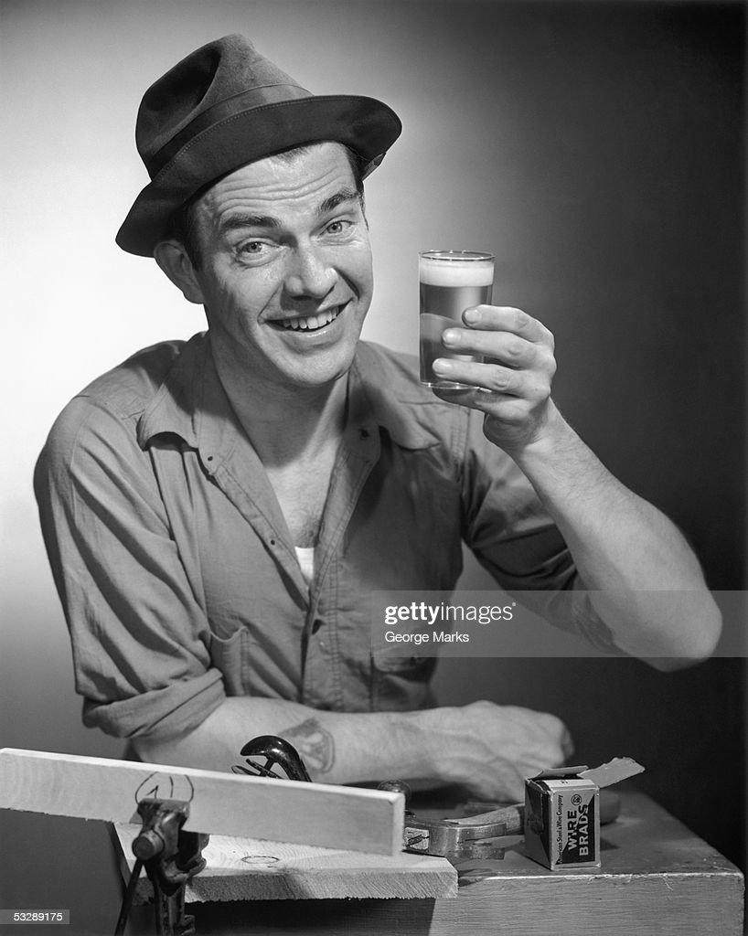Worker enjoying glass of beer : Stock Photo