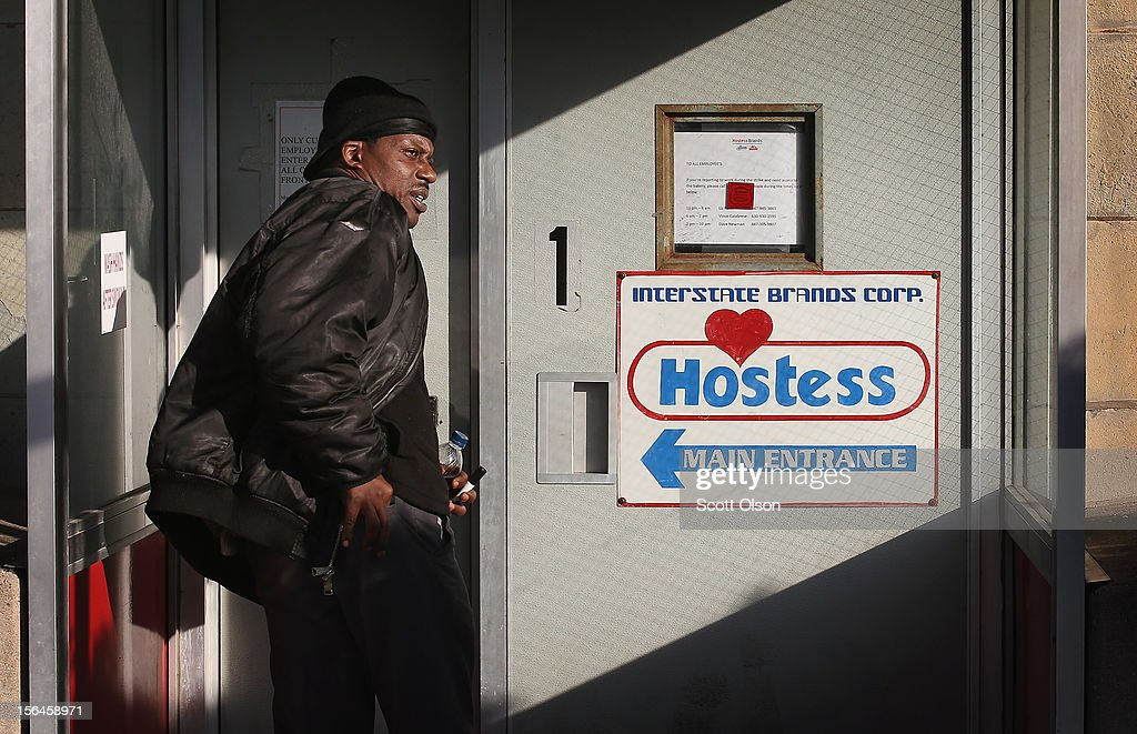 A worker enters the Hostess Brands bakery on November 15, 2012 in Schiller Park, Illinois. Workers with the Bakery, Confectionery, Tobacco Workers and Grain Millers International Union at the facility have walked off the job. They are not allowed by their contract to strike so they walked off their jobs in a show of support for workers at Hostess facilities that are allowed to strike. Hostess Brands Inc. has warned striking employees that it will move to liquidate the company if plant operations don't return to normal levels this afternoon.