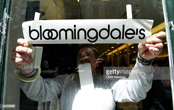 A worker etches the company logo on the door of the new Bloomingdale's location in the Soho neighborhood April 21 2004 in New York City The six level...