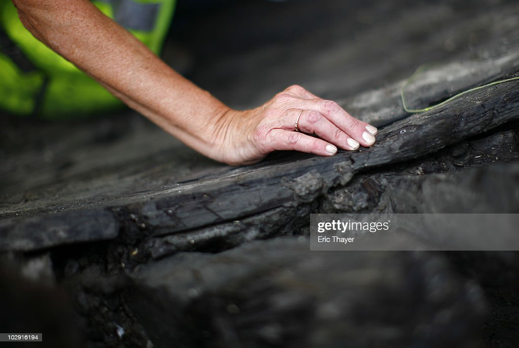 A worker examines remnants of what is thought to be an 18th century ship at the site Ground Zero Construction Site in July 15, 2010 New York City. The wood hulled vessel is approximately 30 feet long and was found 20 to 30 feet below street level on Tuesday morning.