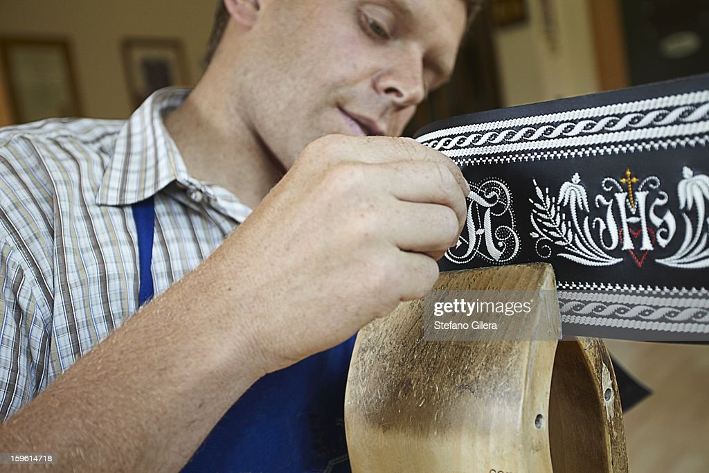 Worker examining weaving in shop : Stock Photo