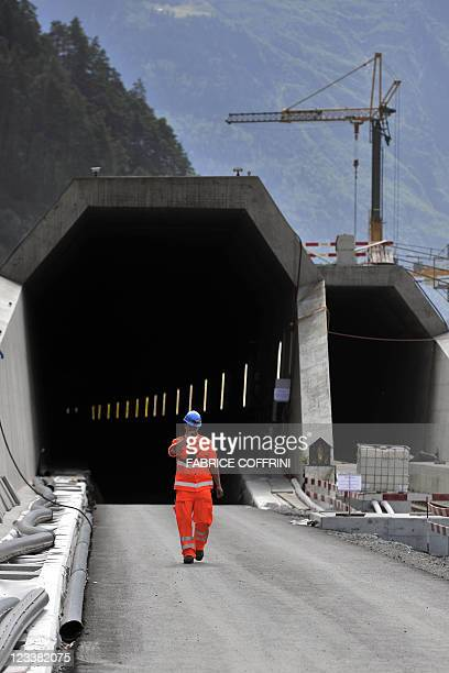 A worker exits the Gotthard base access tunnel during the launching of the installation of railway equipment on September 2 2011 in Erstfeld central...