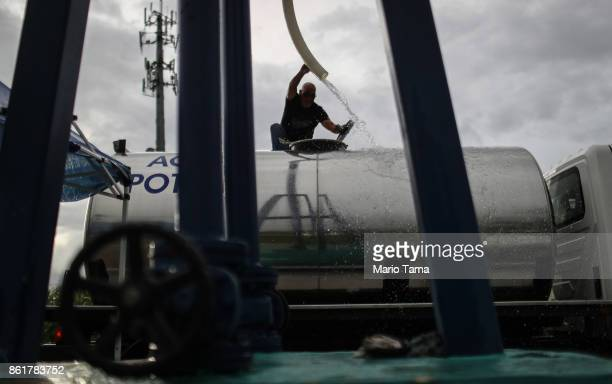 A worker fills a potable water truck with water provided at a pump by water authorities on October 15 2017 in Dorado Puerto Rico A CNN team found...