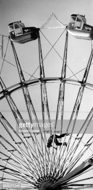 A worker finishes the erection of an amusement ride the day before the opening of the Marshfield Fair in Marshfield Mass Aug 16 1984