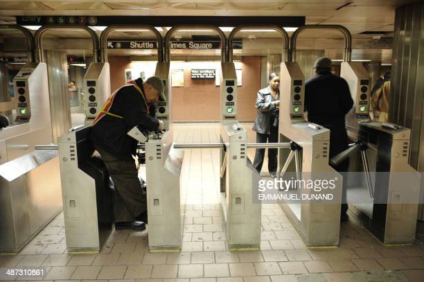 A worker fixes a subway turnstile at a subway station in New York May 20 2008 The New York subway which carries some five million people daily is...