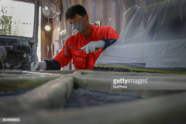 Worker forming process about make to rear seat frame at mohenic garages in Paju South Korea A 20yearold beat up Hyundai SUV isn't anyone's idea of a...