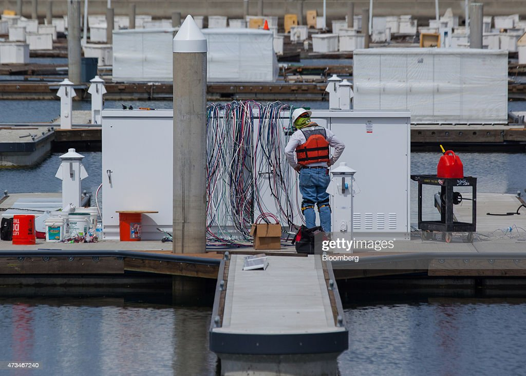 worker from bellingham marine industries inspects wiring on new boat picture id473467240 california port city sells bonds to make room for bigger yachts marine wiring at webbmarketing.co