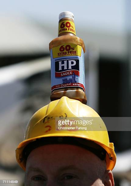 A worker from Birmingham's HP Sauce company protests outside the factory against closure on June 3 Birmingham England The HP Foods factory in...