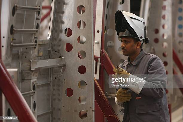 A worker from India welds the fuselage of a subway car destined for New Delhi India at the train factory of Canadian company Bombardier on February...