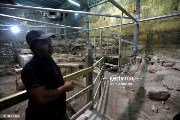 A worker from the Israeli Antiquity A uthority site at the recently discovered ancient roman theatre from the second sanctuary that was found at the...