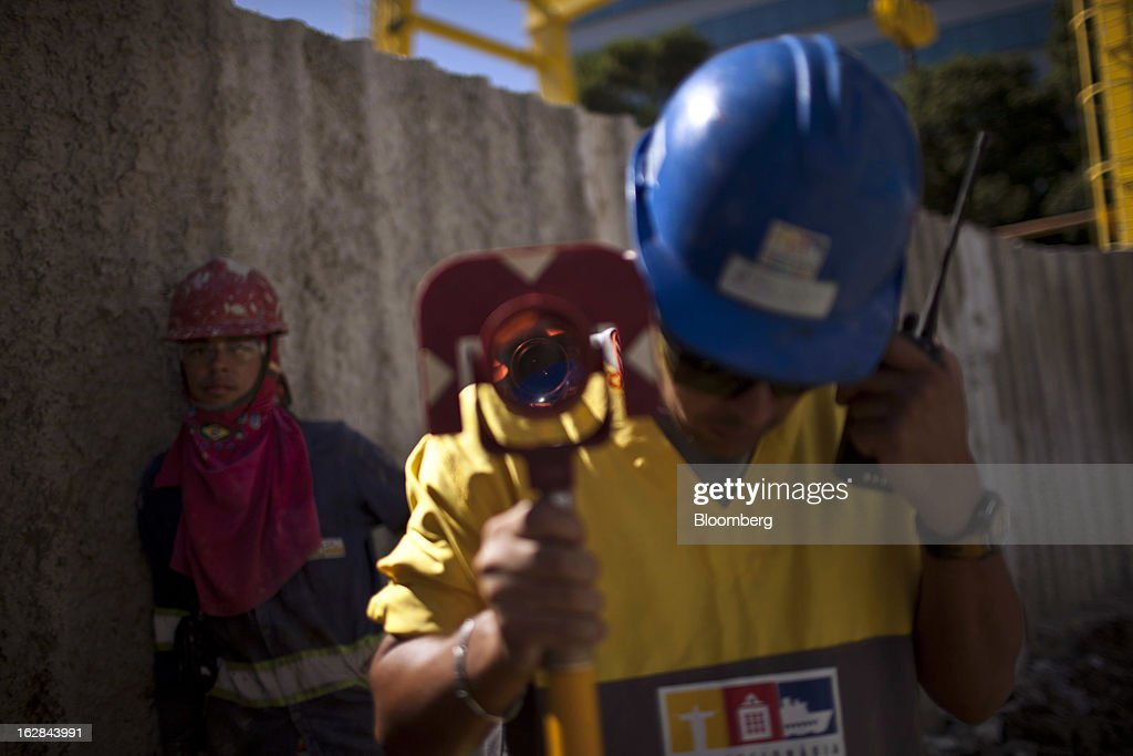 A worker from the Novo Porto Consortium, a group funded by a mix of public and private agencies, speaks on a walkie-talkie at a construction site in Rio de Janeiro, Brazil, on Thursday, Feb. 21, 2013. The tunnel is part of the $4 billion Porto Maravilha infrastructure project which aims to revitalize the the city's downtown and port area ahead of Brazil's hosting of the World Cup and Olympic Games. Photographer: Dado Galdieri/Bloomberg via Getty Images