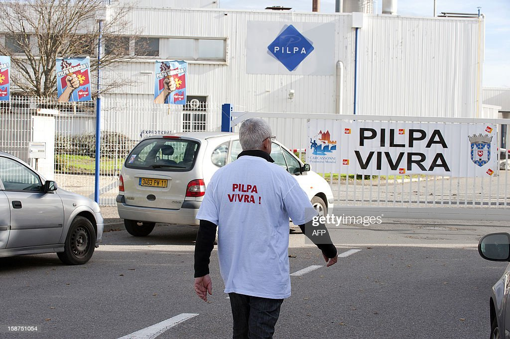 A worker from the Pilpa ice cream factory in Carcassonne, southern France, takes part in surveillance rounds to stop the new factory owner from taking or dismantling factory equipment and machines, on December 27, 2012. 112 workers face the threat of being layed-off since July 2012 when the factory's owner sold the site to the R&R ice cream company and have struggled to keep the site and its jobs ever since. As the workers await court rulings pertaining to the factory site and its future, workers say they are being vigilant and have instituted rounds and a night guard to make sure R&R does not leave with the machines and equipment, thereby making it impossible for workers to consider continuing production at the site. AFP PHOTO / REMY GABALDA
